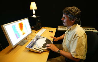 Pscyhology professor with turntable and computer monitor.
