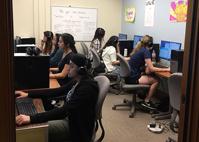 Student esearch assistants are listening to research participants' sound files and transcribing what they're saying